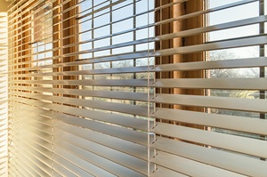 window blinds on wooden window frame