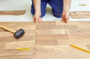 man laying hardwood floor